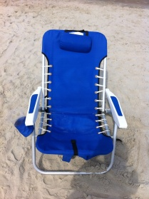 Ah, and a comfy chair. These are great because they have shoulder straps for carrying, a pocket on back for stowing that sunscreen, and built in cup holders!