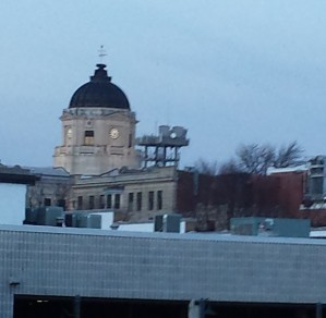 A blurry courthouse from afar